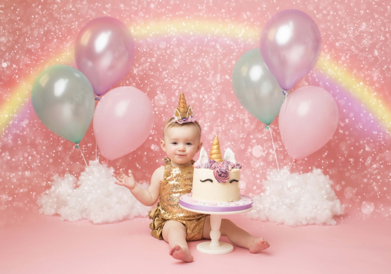 Unicorn and Rainbow first birthday cake smash at Wirral studio