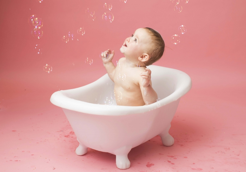 Playing with bubbles in the bath at Wirral photo studio