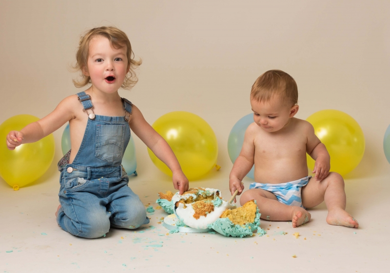 Siblings enjoying smashing a cake at Wirral studio in Hoylake