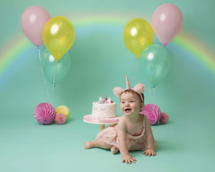 Unicorn and Rainbow Cake Smash at family photography studio in Hoylake, Merseyside