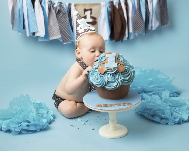 Boy enjoying eating a massive custom made cupcake - Wirral Cake Smash and Splash Photographer
