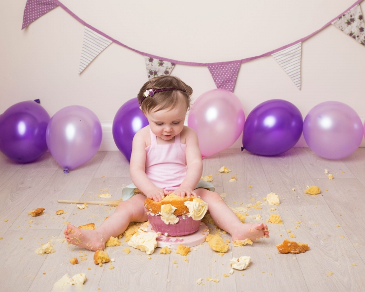 Pink and Purple custom themed cake smash at award winning family photo studio Wirral