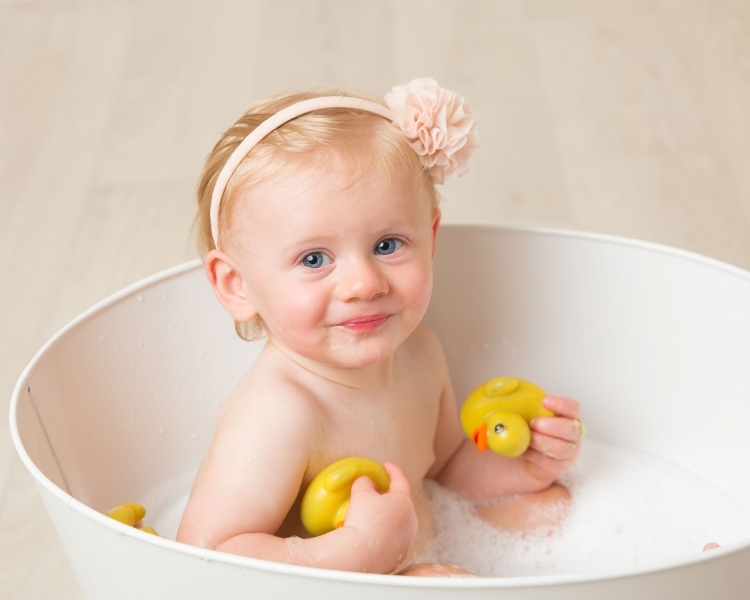 Bath time at Wirral photo studio after 1st birthday cake smash