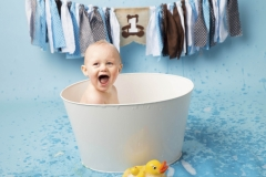 Boy enjoying playing with bubbles in a vintage tin bath - Wirral Newborn and Maternity Photography Studio