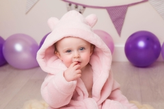 Pink and Purple custom themed cake smash at award winning family photography studio Wirral