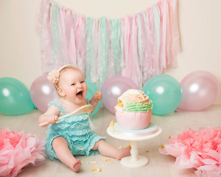 Cake Smash with pastel coloured draping bunting with matching cake and outfits
