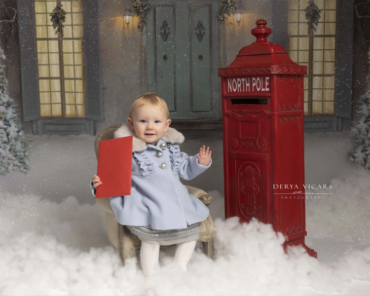 Little girl sitting with her letter to Father Christmas - Wirral Christmas Photoshoots