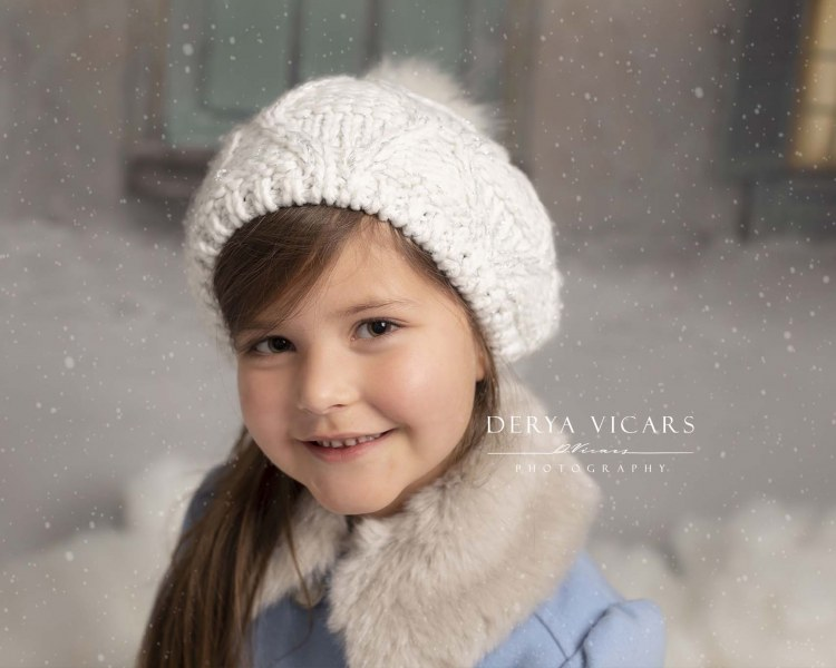 Girl in white hat at Christmas in Merseyside studio