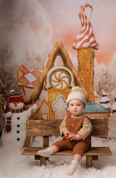 Boy in matching gingerbread outfit in Merseyside, Cheshire and Wirral photo studio