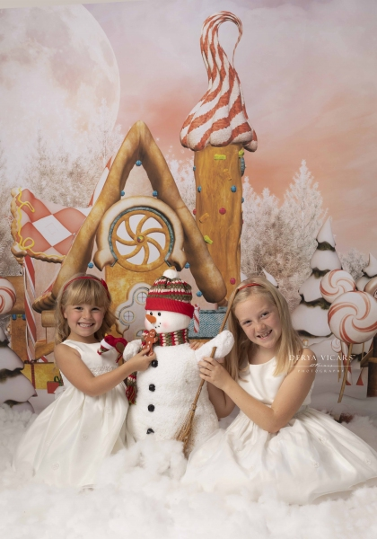 Gingerbread Village with two sisters and a snowman - Heswall Photography