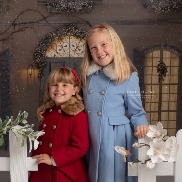 Two sisters in Merseyside photo studio at Christmas