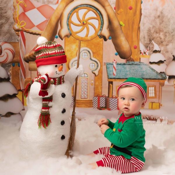 Snowman greets little Elf in Gingerbread Village