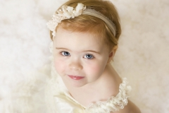 Photo studio Wirral - girl in white dress with matching head band