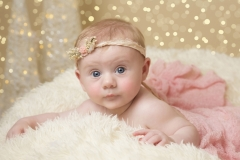 Photography Studio Wirral - Child portraits - girl in pink dress with matching headband