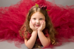 Girl in red dress at family and child portrait studio Wirral