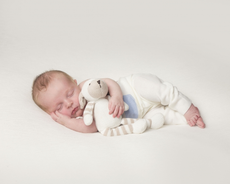 Baby sleeping with teddy toy all natural colours cheshire and north west baby photo studio