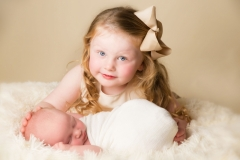 Sister with newborn sibling - Professional Studio in Wirral