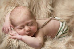 Baby with head resting on hands and arms - Moreton Photoshoot
