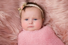 Newborn girl in pink cotton wrap with matching headband - Photography Studio Local North West