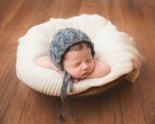 Newborn Baby Photoshoot - Wirral Merseyside - Baby in Natural Coloured Blanket and Blue Hat