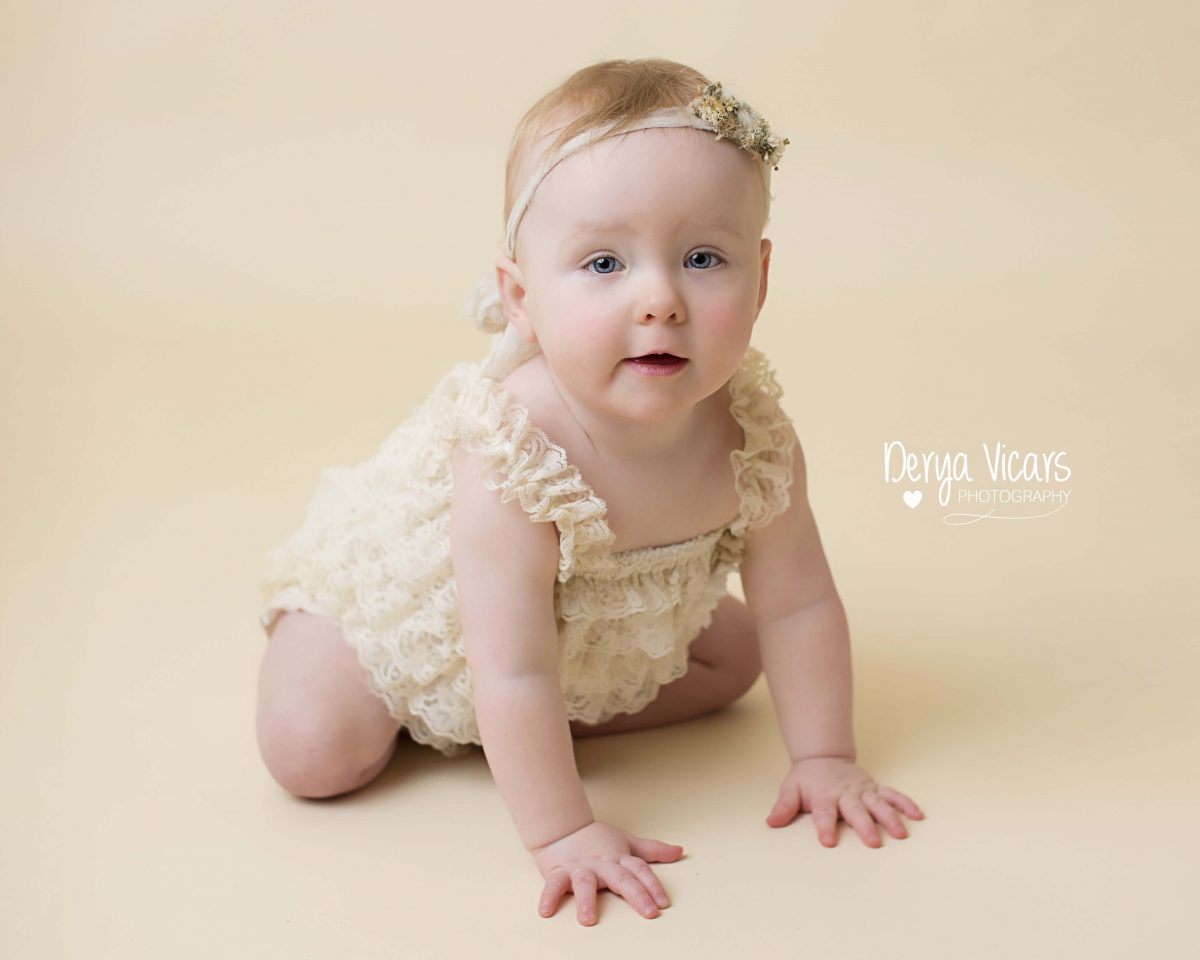 Baby in Pretty Cream Dress before Cake Smash at Best Photographer Wirral